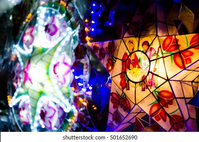 Christmas parol/lantern with graphics of baby Jesus, Mary and Joseph