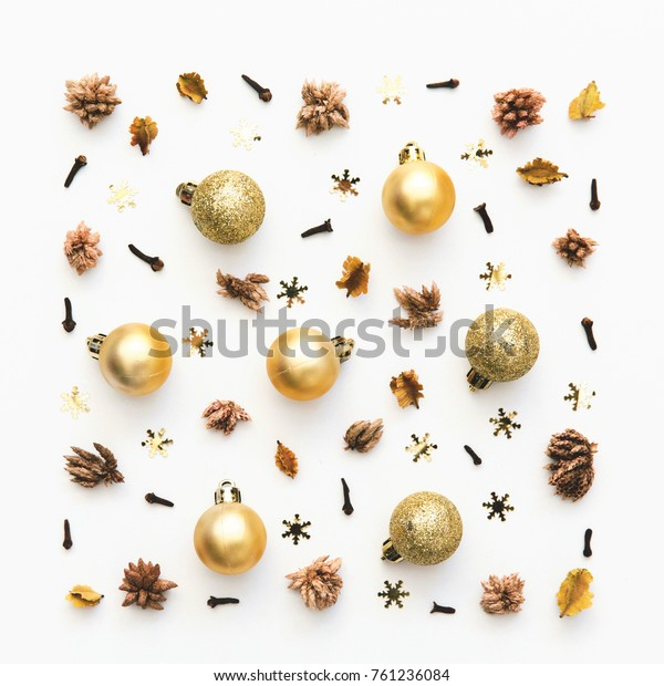 Christmas pattern with decorations in gold tone. Top view, flat lay
