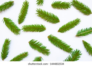 Christmas pattern with fir branches. Winter flat lay style picture. Natural christmas pattern made of fir branches. White isolated background. New year consept