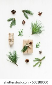 Christmas pattern with pine cones, fir branches, christmas gift. Top view, flat lay
