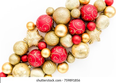 Christmas pattern: red and gold glass Christmas balls on a white background. the apartment lay, top view