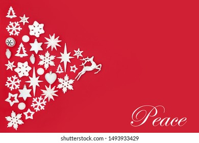 Christmas peace abstract background with white and silver tree decorations and symbols on red with copy space. Traditional theme for the festive season.