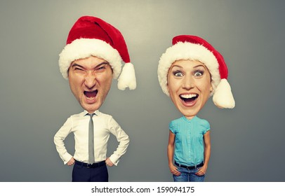 christmas photo of angry man and happy woman over grey background