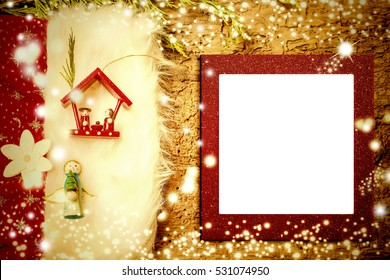 Christmas photo frame card, Nativity Scene and Angel cute figurines on old wooden background with empty photo frame.