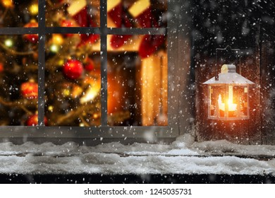 Christmas photo of window sill with lamp of fire and home interior with christmas tree. Snowflakes and ice decoration. Free space for your decoration.