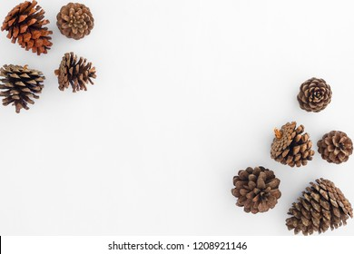 Christmas pine cones on white paper border composition. Creative flat lay, top view design