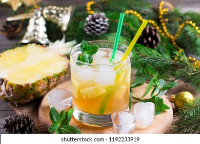 Christmas pineapple lemonade with mint on a wooden background
