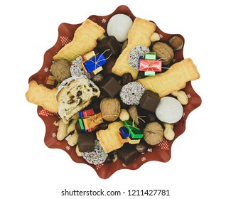 Christmas plate with different varieties of cookies, chocolate and nuts