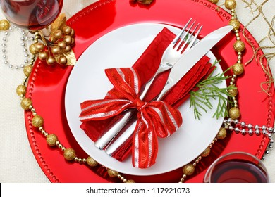 Christmas plate and silverware with red wine
