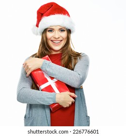 Christmas portrait of smiling  Santa woman holding gift box isolated on white background. Female model with long hair.