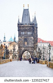 Christmas in Prague, Czech Republic. Medieval tower on Charles Bridge with street lamps and statues. Famous popular touristic landmark. Winter snowfall.