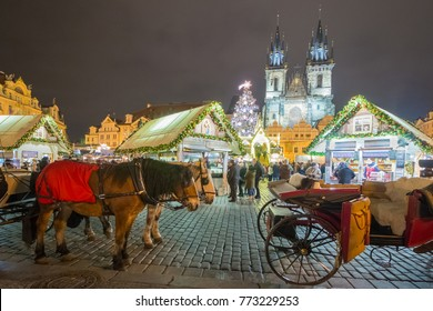 Christmas in Prague on the Old Town Square with team of horses in the foreground.