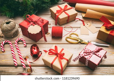 Christmas preparation. Gift boxes wrapping on wooden background