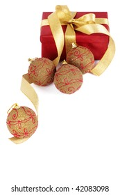 Christmas present with balls in golden tone