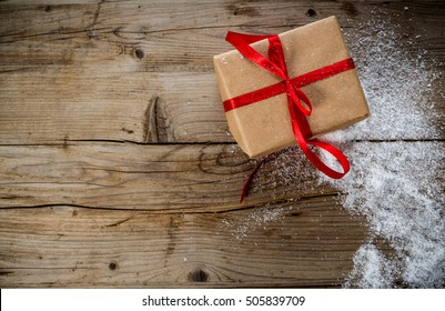 Christmas Present on a wooden vintage background