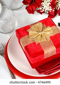 Christmas present in a romantic table setting with roses