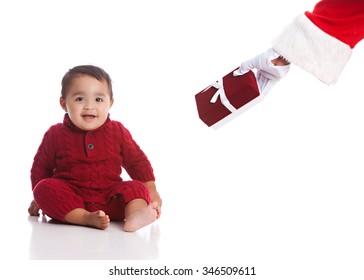 Christmas Present from Santa. Adorable mixed race baby boy receiving a Christmas Present from Santa.