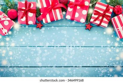 Christmas presents with decoration on blue wooden table in vintage color filter,selective focus