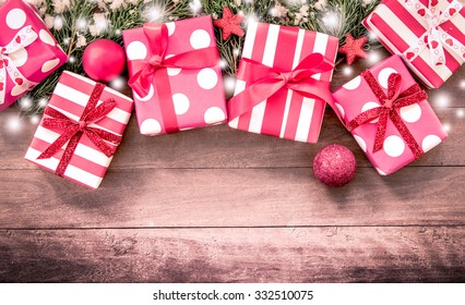 Christmas presents with decoration on wooden table in vintage color filter
