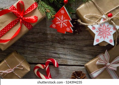 christmas presents in decorative boxes white wood background