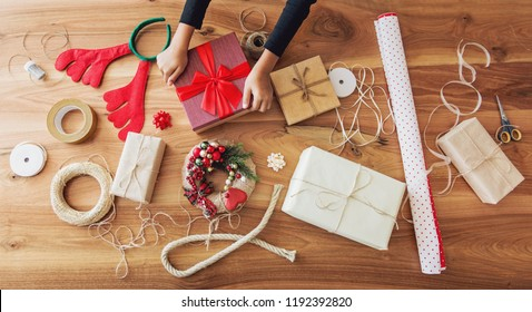 Christmas presents and gift wrapping equipment on the table
