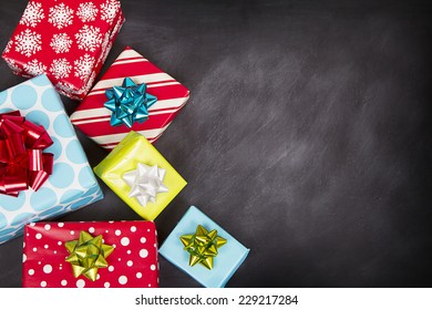 Christmas presents grouped around a chalkboard