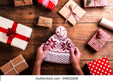 bff2d98dee Christmas presents laid on a wooden table background