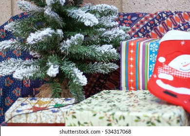 Christmas Presents near a tree with stocking