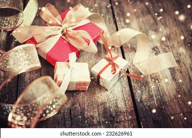 Christmas presents  on dark wooden background in vintage style / Selective focus
