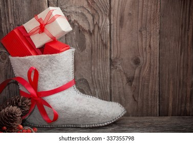 Christmas presents on old wooden background