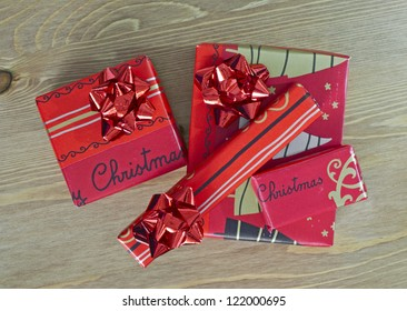Christmas presents on a wooden background