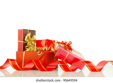 Christmas presents in red boxes against white background