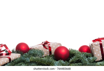 Christmas presents and red bulbs on fir branches with copy space isolated on white background