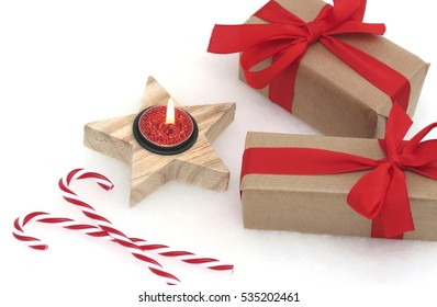 Christmas presents with red ribbons against a white background