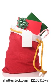 Christmas presents in a red Santa sack on a white surface