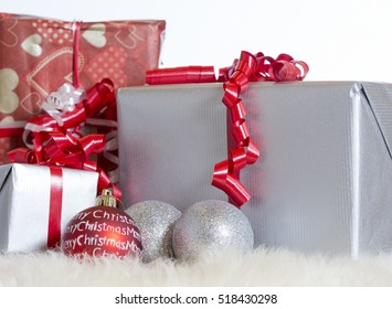 Christmas presents. Some decoration balls next to the packages.