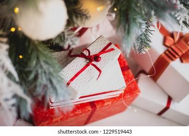 Christmas presents under Christmas tree.