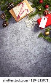 Christmas presents wrapped in various decoratiove papers on a stone background viewed from above. Copy space. Top vew
