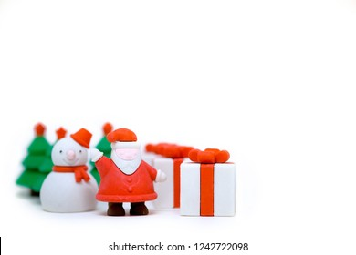 Christmas prop for decoration, Santa Claus, Snowman, pine tree and gift box isolate on white background with copy space.