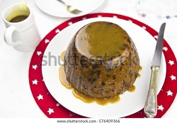 Christmas pudding with caramel sauce