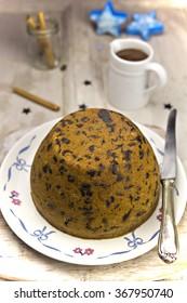 Christmas pudding with chocolate sauce