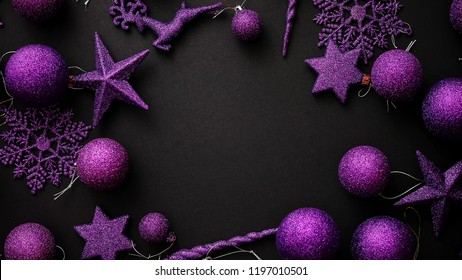 Christmas purple collection, balls and decorative ornaments, on black background. Circle shaped with copy space.