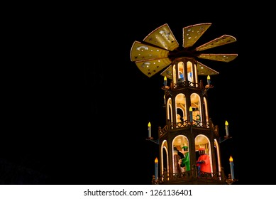 Christmas pyramid, Weihnachtspyramide, attractive decorated Christmas market art and structure, combination of wooden pyramidal outer frame, central carousel  and figures of nativity scenes.