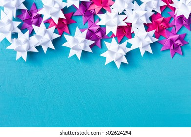 Christmas quiling decoration elements on blue board for background composition