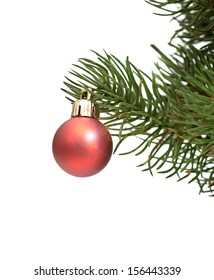 Christmas red ball on green spruce branch