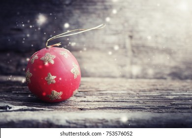 christmas red ball on wooden grunge background