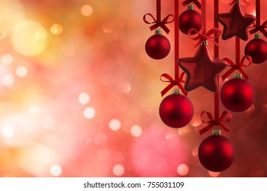 Christmas red balls with ribbons isolated on defocused background