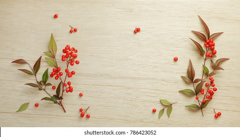 Christmas Red berries of sacred bamboo (Nandina Domestica) flowers on wooden background.