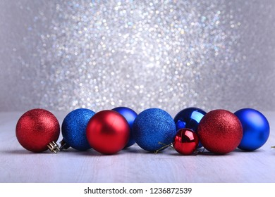 Christmas red and blue balls isolated on silver background