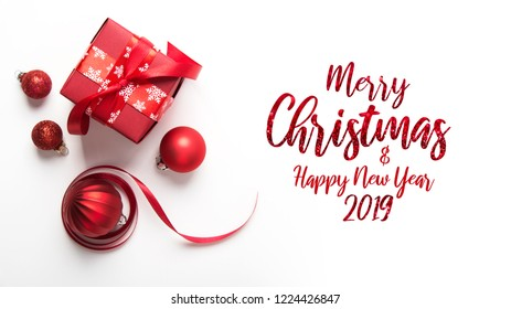 Christmas red gift on white background top view. Merry Christmas greeting card, frame. Winter xmas holiday theme. Happy New Year. Noel. Flat lay